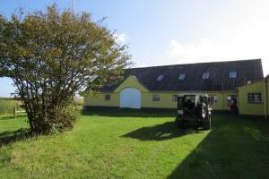 Die Mandø Farm mit Fenstern mit Blick auf das Pferdwiese